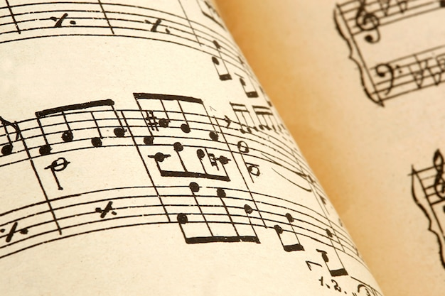 Old paper with vintage sheet music Premium Photo