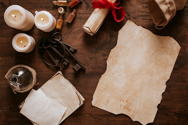 Old parchment and keys near candles Free Photo