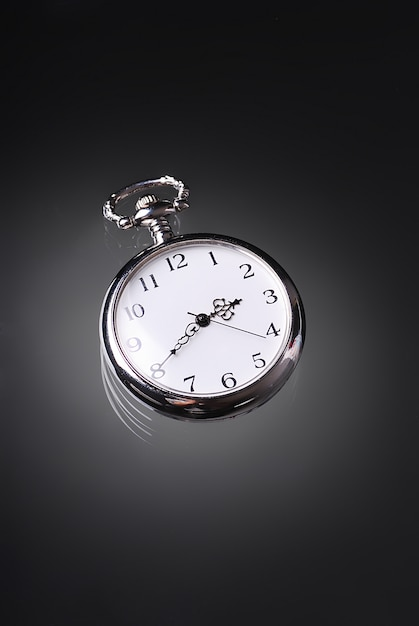 An old pocket watch Premium Photo