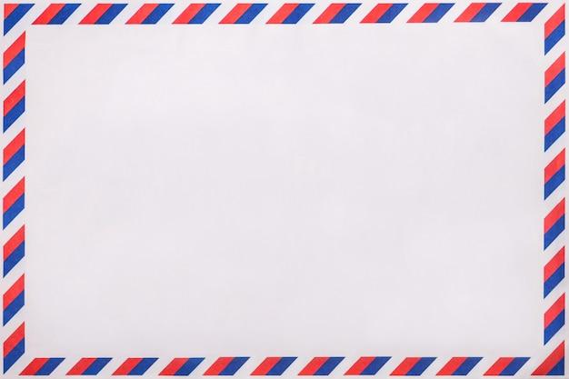 Старый пост полосатый конверт, фон с копией пространства. почта письмо с раздели марочные шаблон. Premium Фотографии