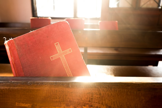 The old red books or red worship songbooks in church Free Photo