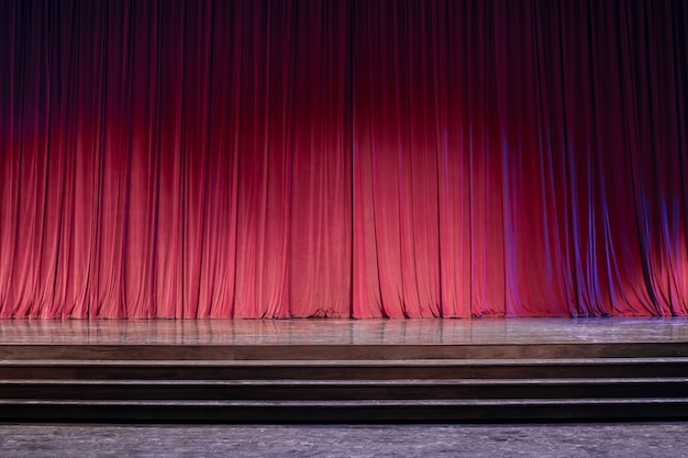 Old red curtains on stage. Premium Photo