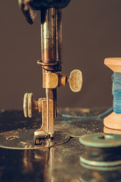 Old retro sewing machine and details of needle close-up of thread Premium Photo