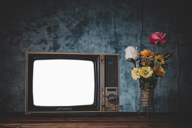 Old retro tv it's still life with flower vases Free Photo