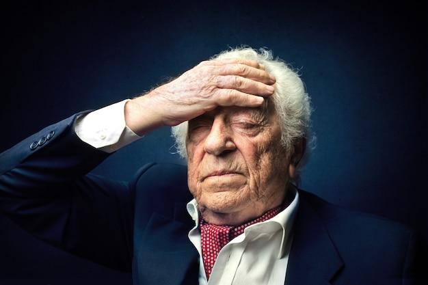 Old rich man having pain Premium Photo