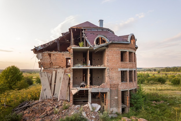 Old ruined building after earthquake. a collapsed brick house . Premium Photo