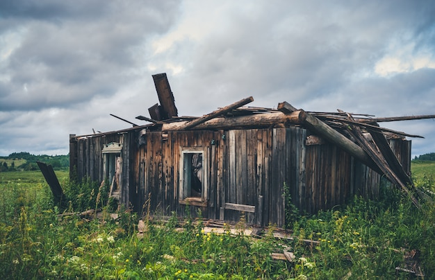 Old ruined wooden rural house. Premium Photo