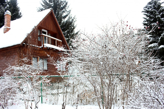 Old rustic wooden house in the snowy forest in winter Premium Photo
