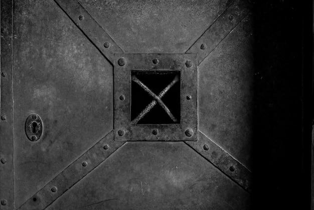 Old, rusty, heavy iron door Free Photo