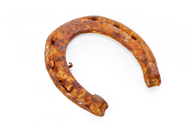 Old rusty horseshoe isolated on white Premium Photo