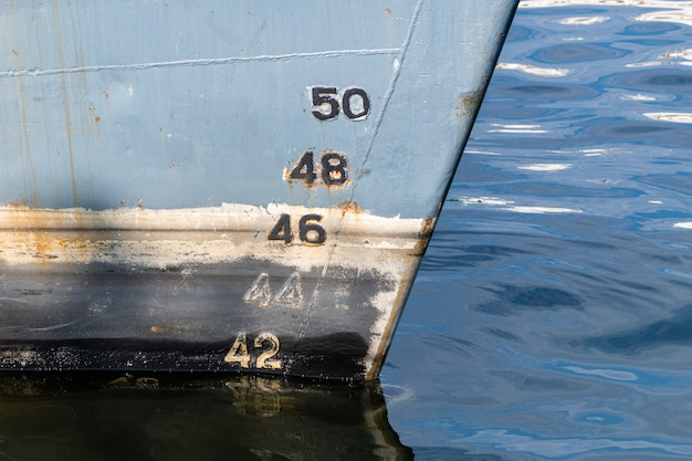 Old ship draft on hull, scale numbering Premium Photo