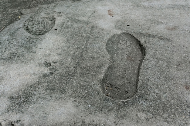 The old single imprint, footprint of shoe or boot on concrete Premium Photo