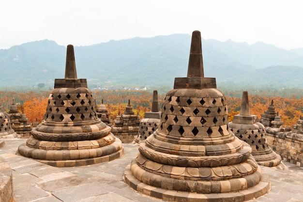 Old stupas in borobudur buddhist temple. mahayana buddhist temple ...
