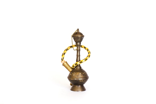 An old traditional decorative hookah. isolated Premium Photo