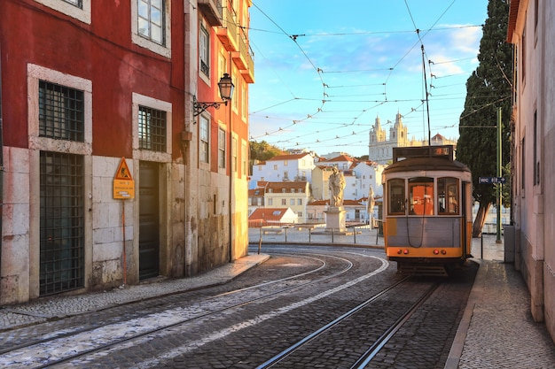 An old traditional tram carriage in the city centre of lisbon, portugal. Premium Photo