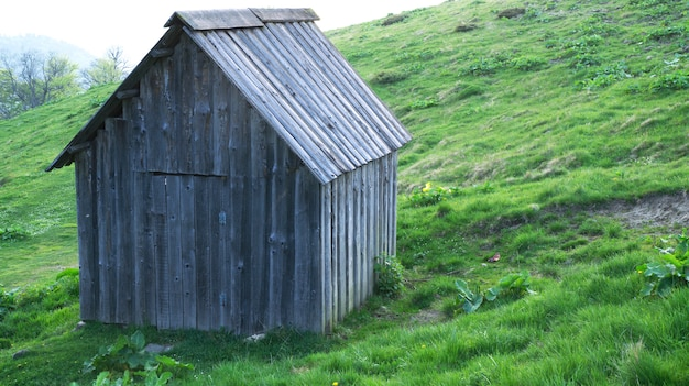 Old and traditional wooden house in mountains Premium Photo