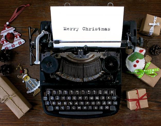 Old typewriter text merry christmas Premium Photo