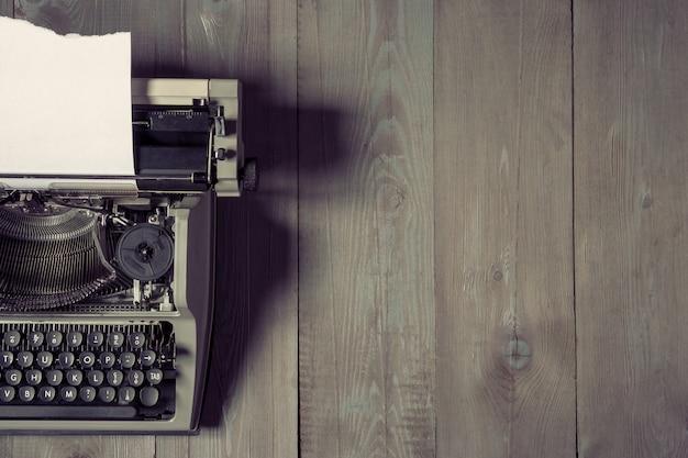 Old typewriter with paper Premium Photo