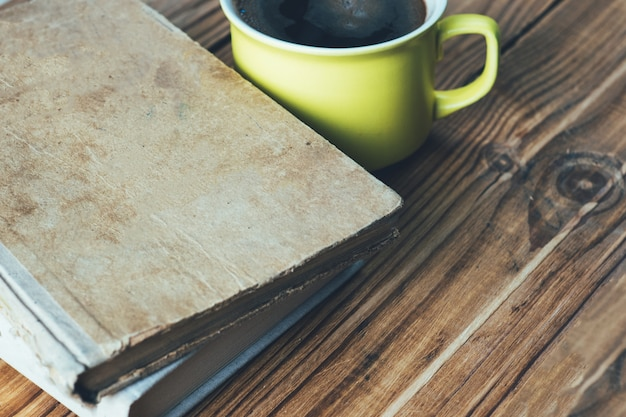 Old vintage battered books and a cup of coffee Premium Photo