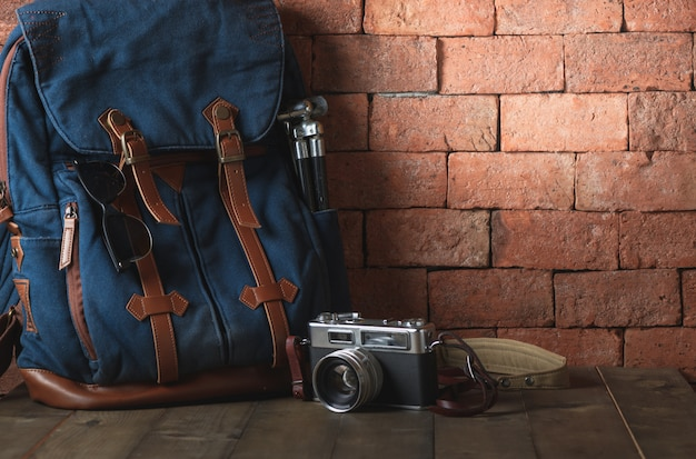 Old vintage canvas bag with vintage camera Premium Photo