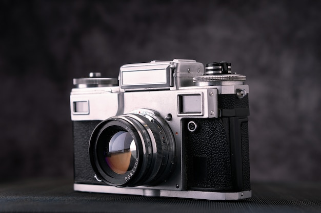 Old vintage film 36mm photo camera, lifestyle memory. take pictures with a manual lens history. Premium Photo
