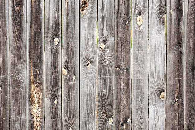 Old vintage planked wood board with holes Free Photo