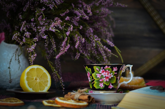 Old vintage tea cup on wooden rustic background Premium Photo