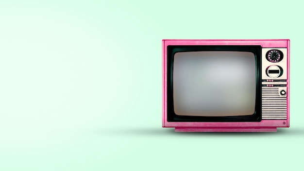 Old vintage tv on green background Premium Photo