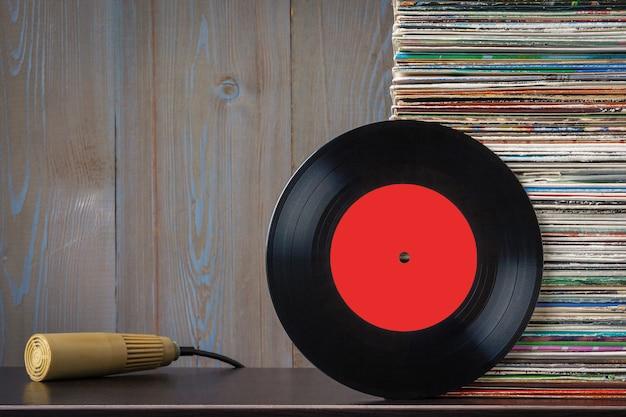 Old vinyl discs and microphone Premium Photo
