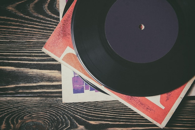 Old vinyl record on the wooden table Premium Photo