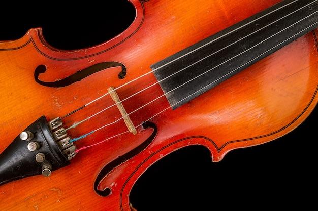 Old violin on a black background Premium Photo