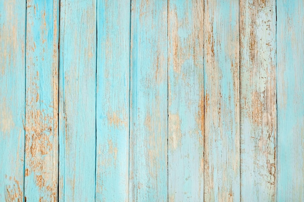 Old weathered wooden plank painted in turquoise blue pastel color. Premium Photo