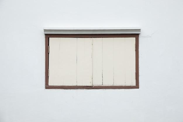 Old window on a white wall. Premium Photo