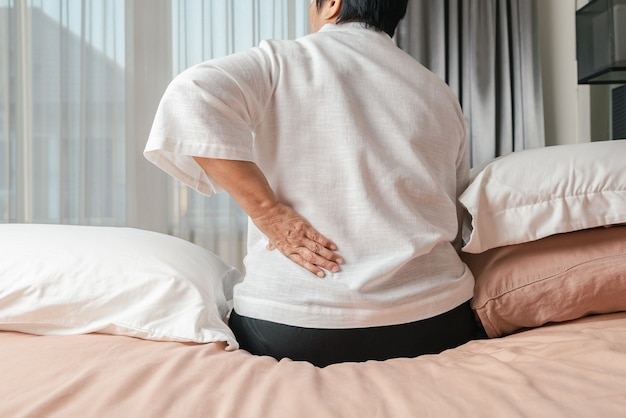 Old woman back pain at home, health problem concept Premium Photo
