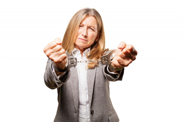 Old woman handcuffed in both hands Free Photo