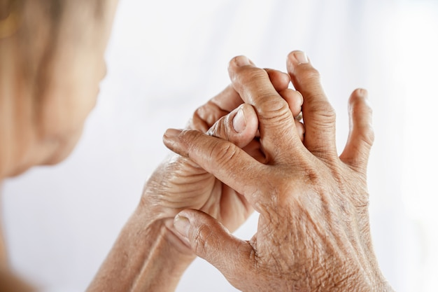 Old woman suffering from gout, joint pain Premium Photo