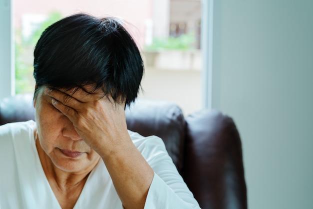 Old woman suffering from headache, stress, migraine, health problem concept Premium Photo