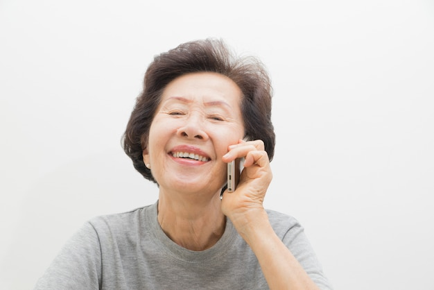 Old women with mobile Premium Photo
