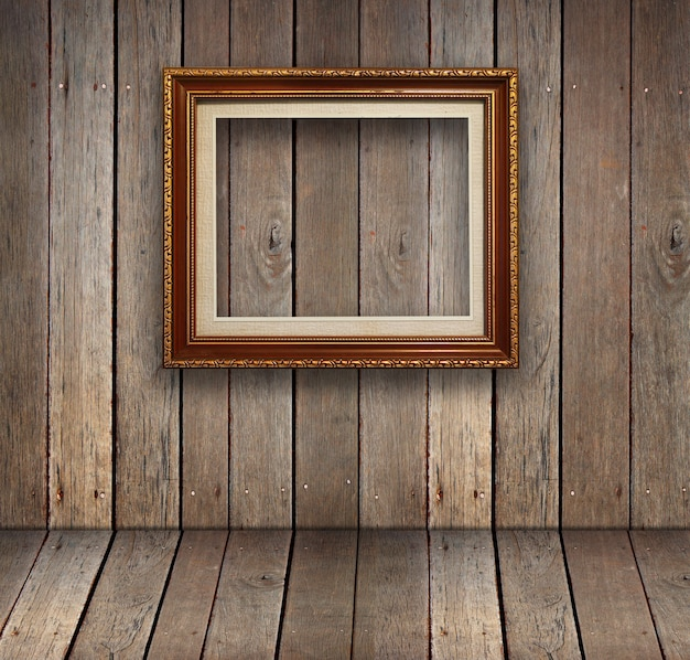 Old wood room with gold frame background. Premium Photo