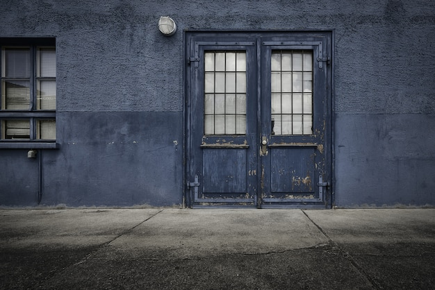 Old wooden door of a blue building during daytime Free Photo