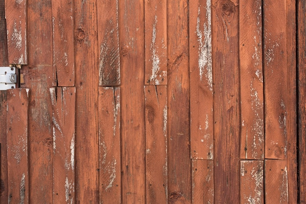 Old wooden door with peeling and cracked paint. Premium Photo
