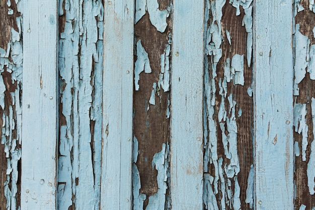 Old wooden door with peeling and cracked white paint. Premium Photo