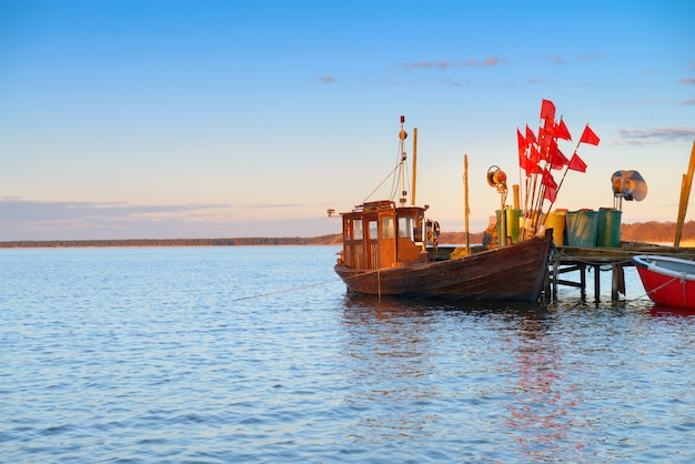 Old wooden fishermens boat on island rugen, northern germany Premium Photo
