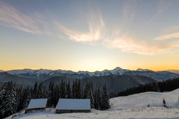 Old wooden house in deep snow on mountain valley Premium Photo