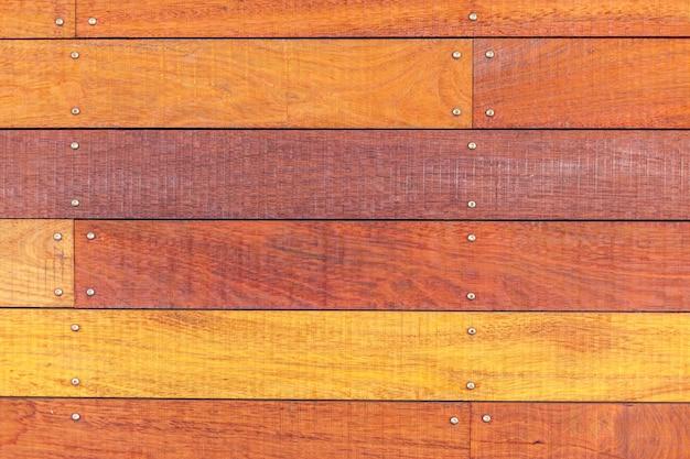 古い木の板の表面の背景。オレンジ色のテクスチャ Premium写真