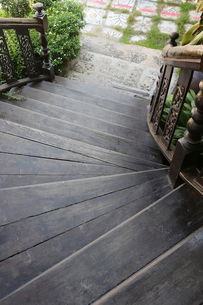 Old wooden stairs down to the garden Premium Photo