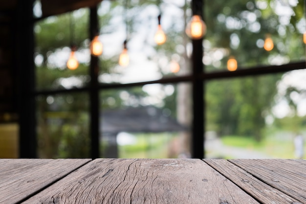 Old wooden table on front with blurred restaurent background, for persentation object Premium Photo