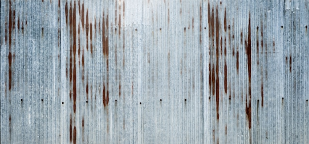 Old zinc surface background the rust on the surface of zinc. which is taken from the fence next to the house. Premium Photo