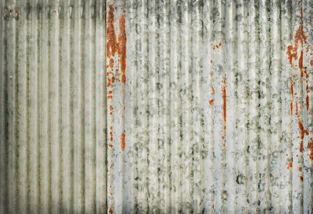 Old zinc wall texture, rusty on galvanized metal panel sheeting. Premium Photo