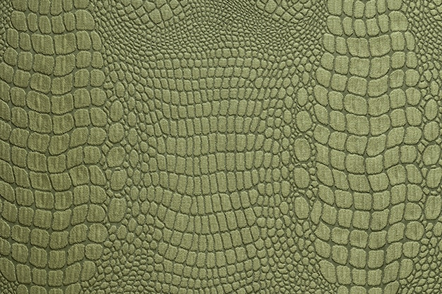 Olive green crocodile skin texture as a wallpaper Premium Photo
